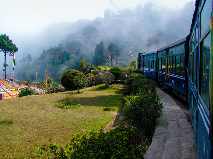 take a joyful ride in the toy train at darjeeling, one of the cheapest places in india
