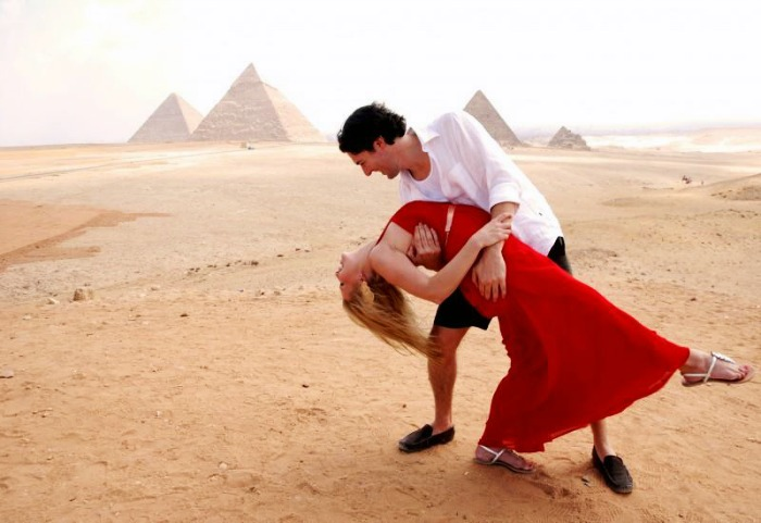 Couple in front of the Pyramids in Egypt