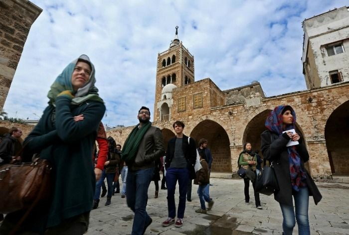 Tourists visit the Mamulk-era Great Mosque, Lebanon