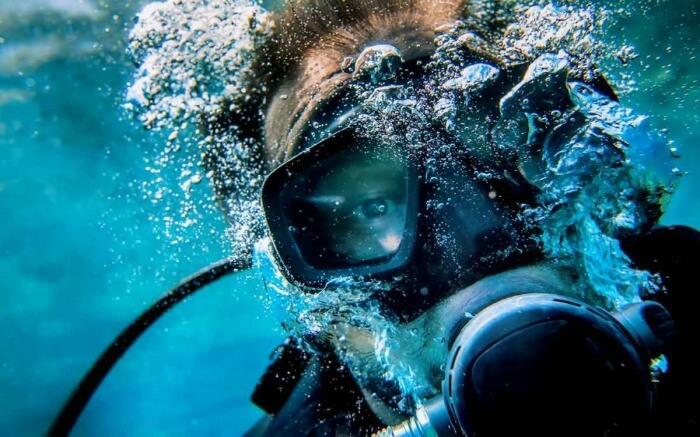 Scuba divers blowing bubbles