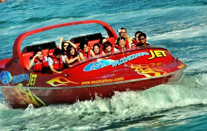 Tourists ride speed boat near Wuzhizhou Island in Sanya, China