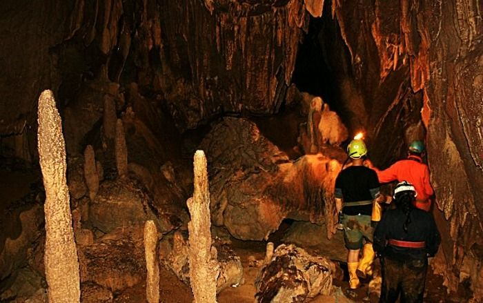 Tourists exploring cave in Meghalaya
