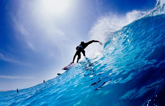 Surfing along the azure waters of the Indian Ocea, Arugam Bay