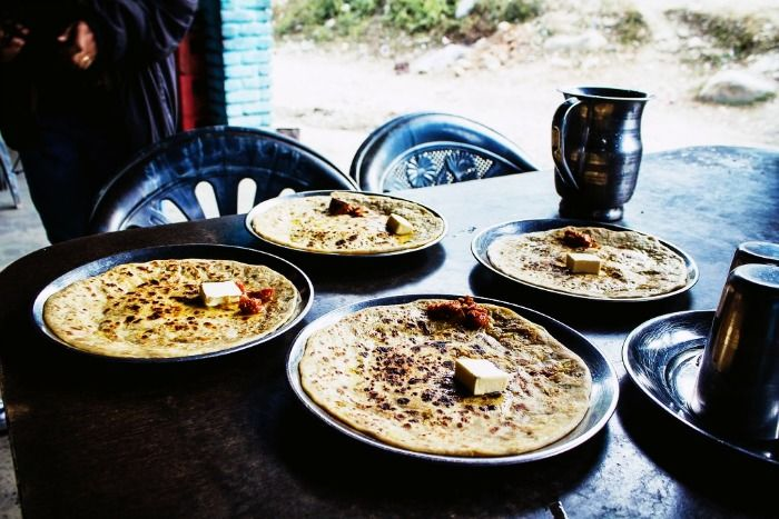Butter rich stuffed kulchas served with pickle at Deepak Dhaba in Dhanaula