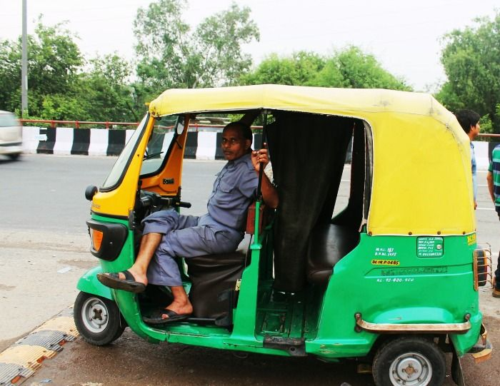 An autowala waiting for his safari