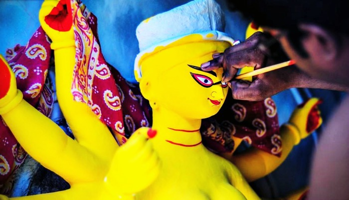 An artist painting the idol of goddess Durga in Kolkata