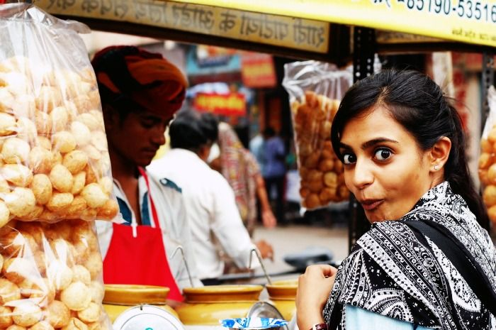 A girl excited about eating the best Gol gappas in Delhi
