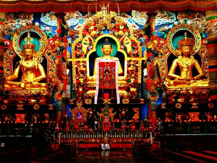 Golden statues in Golden Temple Complex in Coorg