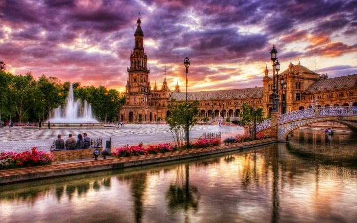 A dreamy view of Seville with fountain and bridge