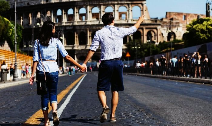 A couple sightseeing in Rome on their honeymoon