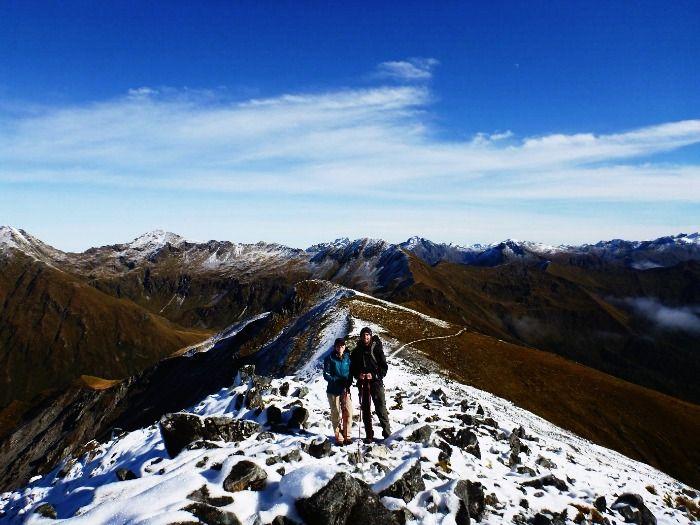 A Couple trekking in their honeymoon in Switzerland