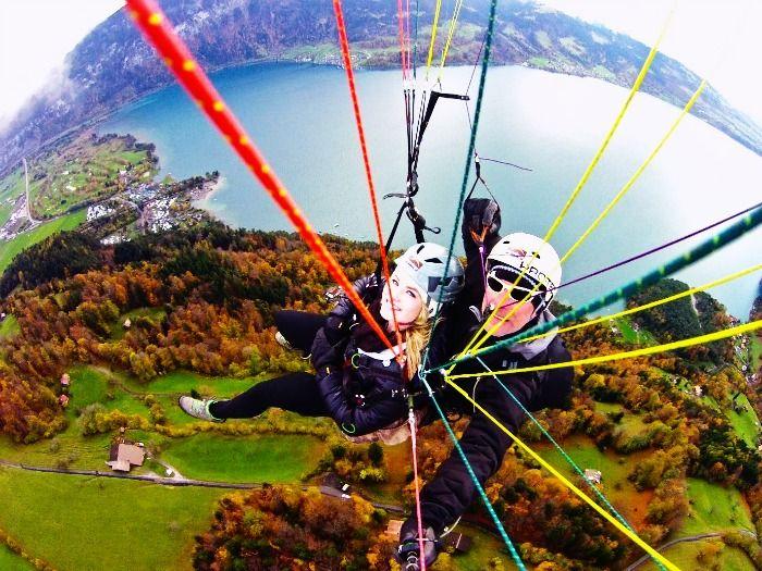 A couple paragliding on their honeymoon in Interlaken