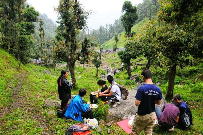 Trekkers stop by the mystical verdant valley for a break during Nagtibba Trek