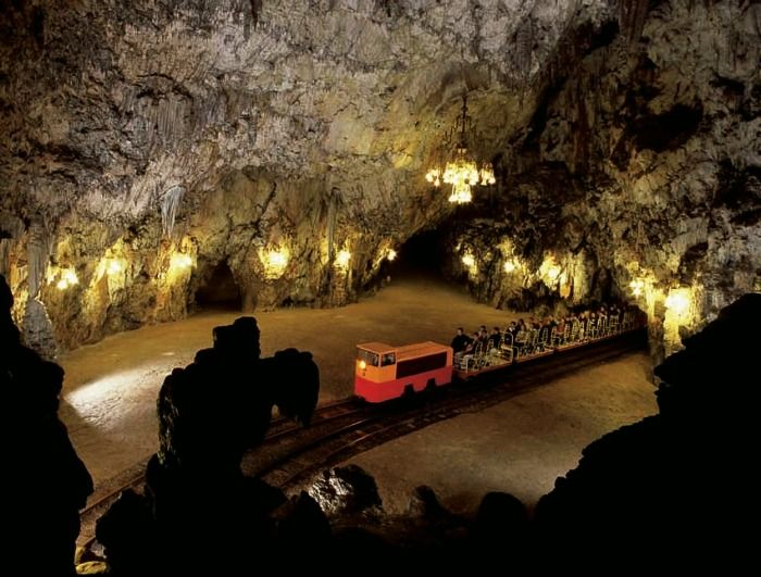 Explore the underground caves in Slovenia