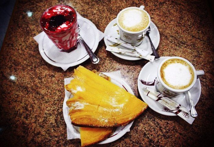 Sugar topped pastry of custard along with Portuguese cappuccino makes for a wonderfully tasty breakfast.