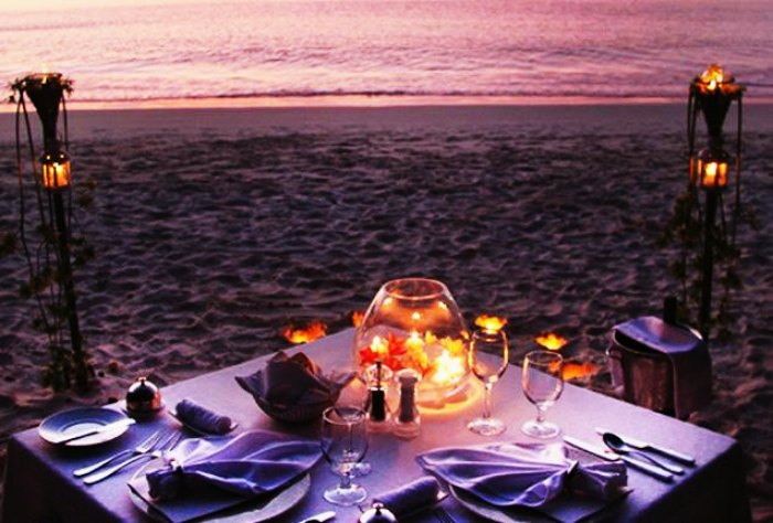 A candlelit dinner set up in Seychelles