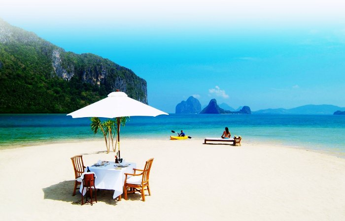 Couple on the beach in El Nido, Philippines