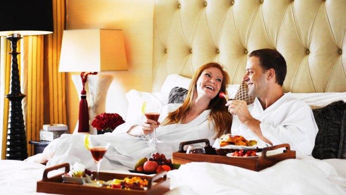 Couple enjoying a luxurious breakfast in Singapore