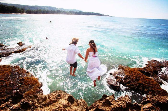 Adventure seeking couples cliff jumping in New Zealand