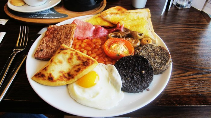 The delicious Scottish breakfast is laden with fried eggs along with back bacon, black pudding and buttered toast.