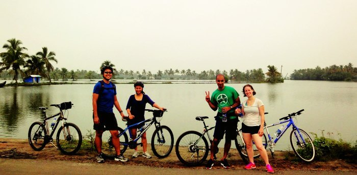 Cyclists stop by to click themselves over their cycling expedition from Kochi to backwaters