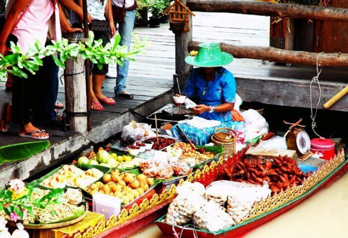 A fruit vendor at the floating market in Pattaya