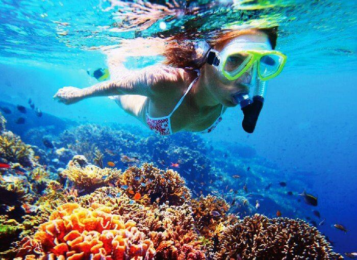 A girl snorkeling in Thailand