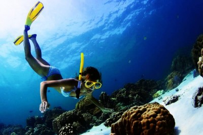 Snorkeling in Maldives in the azure blue waters is an amazing experience