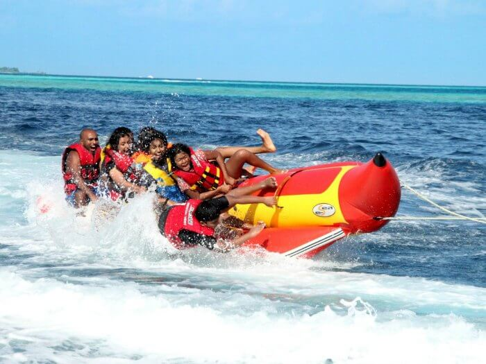 A group of people enjoying a ride on a banana boat in Andaman