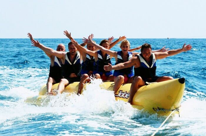 Friends enjoying the banana tube boat ride in Goa