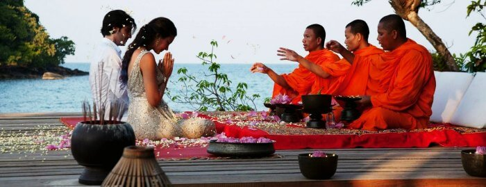 Honeymoon Couple Seeking Blessings in Cambodia