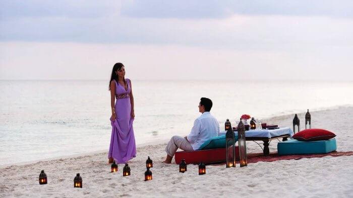 A Honeymoon couple on a romantic date on Mirissa beach
