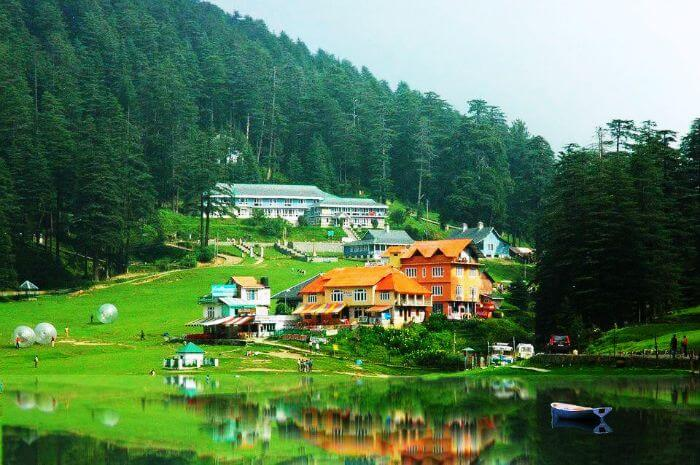 A serene view of the lake in Khajjar with Zorbing taking place in distant background
