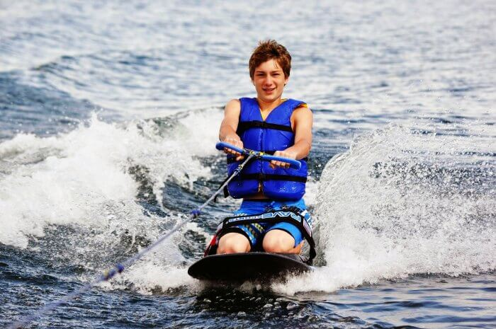 A kid Kneeboarding in Goa