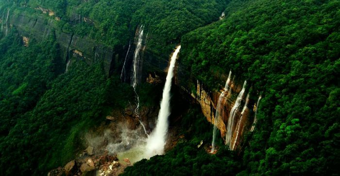 A breathtaking bird's-eye view of the greens and the Nohkalikai Falls in Cherrapunji