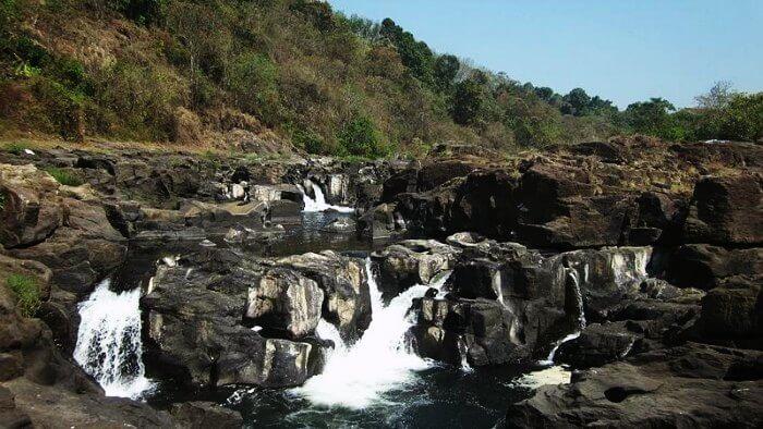The beautiful Perunthenaruvi Waterfalls in Kerala