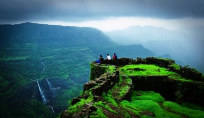 Trekkers enjoying the gorgeous views of the valley from Rajmachi peak during monsoons