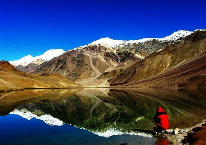 A splendid view of reflection of snow capped hills at Chandertal Lake
