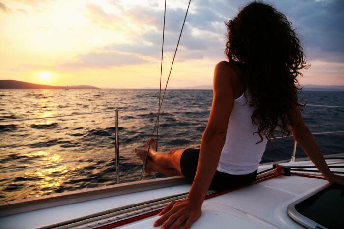 Sail through the ocean during sunset