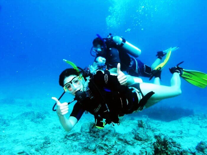 A woman scuba diving in Goa