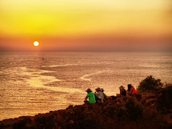 People hanging out at Chapora fort in Vagator beach