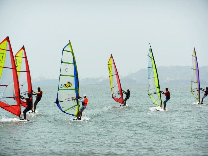 Adventurous surfers windsurfing in Goa