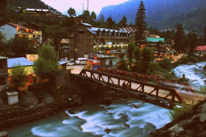 A scenic view of the flowing beas and the bridge leading to Old Manali