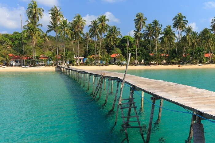 Wooden pontoon in the turquoise tropical sea of Ao Phrao beach in Koh Kut island