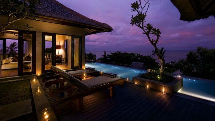 A romantic candle-lit evening at Conrad Bali over water villa