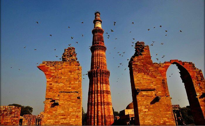 Wings taking on to the Qutub Minar
