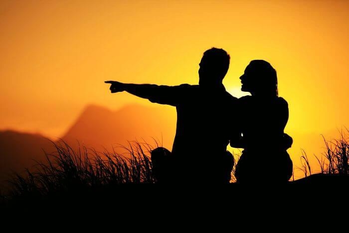 A couple enjoys the sunset at a resort in Munnar.