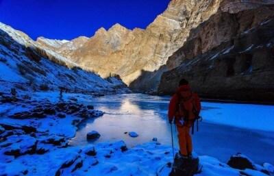 A trekker stops before starting the walk on the frozen river during Ladakh Zanskar trekking