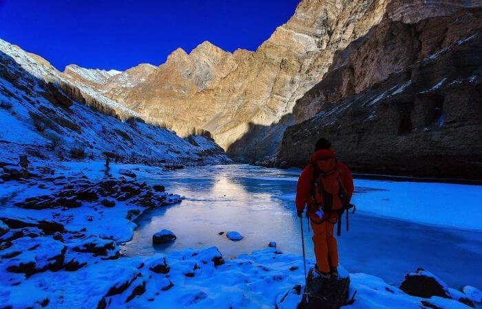 A trekker stops before starting the walk on the frozen river during Ladakh Zanskar trekking