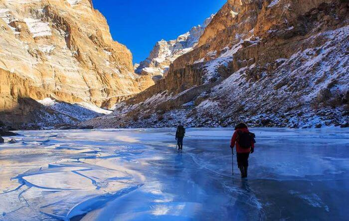 Trekkers walk on the ice sheet during Chadar trek